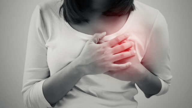 Woman clutching her heart in pain