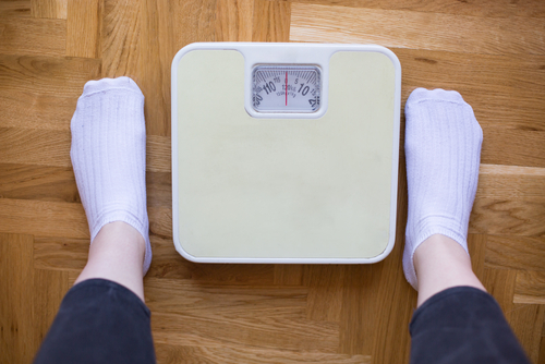 Standing on a Scale to Check Your Weight